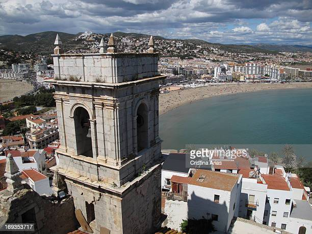 View of the beach and the town of Peniscola with the tower of the church of Our Lady of the Ermitana in the foreground Castellon Valencian Comunity...