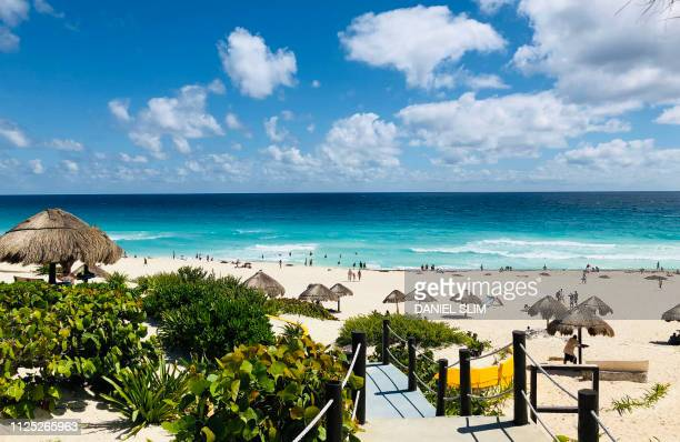 View of the beach as seen from one of the accesses in Cancun Quintana Roo State Mexico on February 16 2019 Playa del Carmen and Cancun are the top...