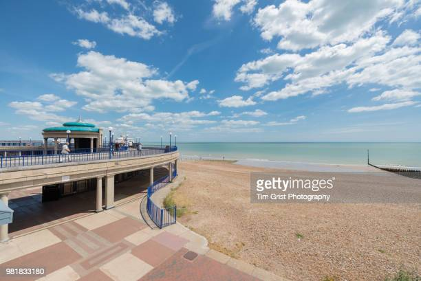 view of the beach, bandstand and promenade, eastbourne, east sussex, uk - eastbourne stock pictures, royalty-free photos & images