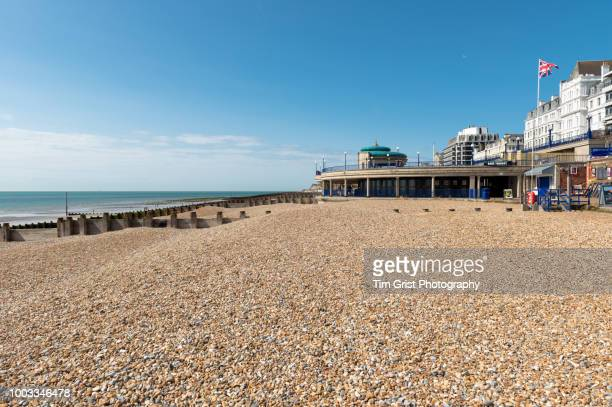 view of the beach, bandstand and promenade, eastbourne - eastbourne stock photos and pictures