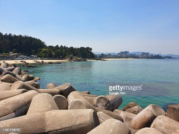 a view of the beach from the seawall - seawall stock pictures, royalty-free photos & images
