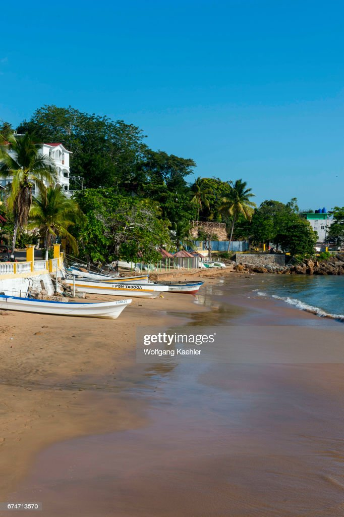 View Of The Beach With Fishing Boats In Front Of The Village Of The Tropical Island