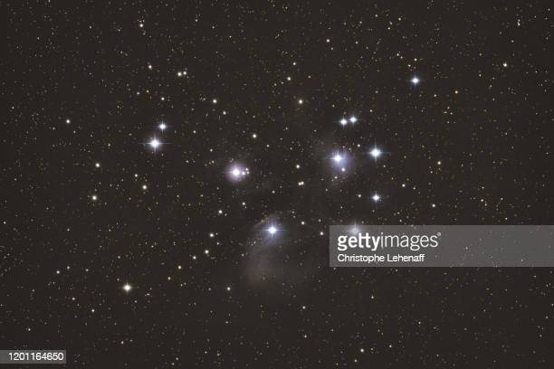 view of the beautiful stars cluster named the pleiades (m45), in the constellation of taurus - アナハイム・エンゼルス stock pictures, royalty-free photos & images