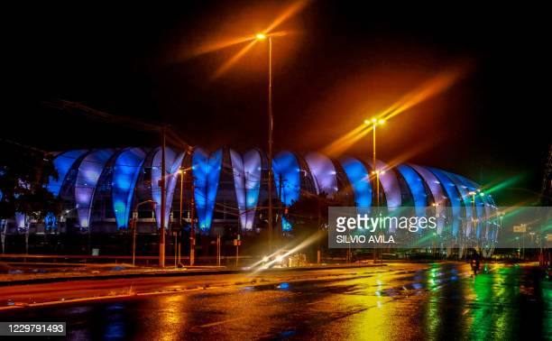 View of the Beira-Rio stadium of Sport Club Internacional lit with the colours of the Argentine flag in honor of Argentinian player Diego Armando...