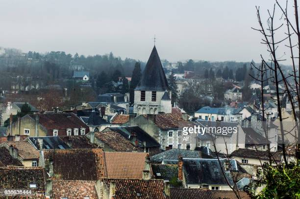 view of the bell tower of the notre-dame church in chauvigny, france - chauvigny stock pictures, royalty-free photos & images