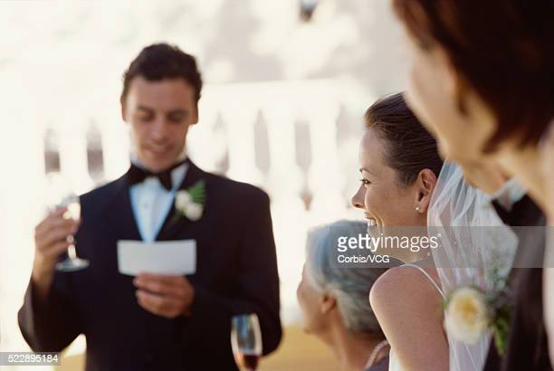 View of the best man making a speech at a wedding reception