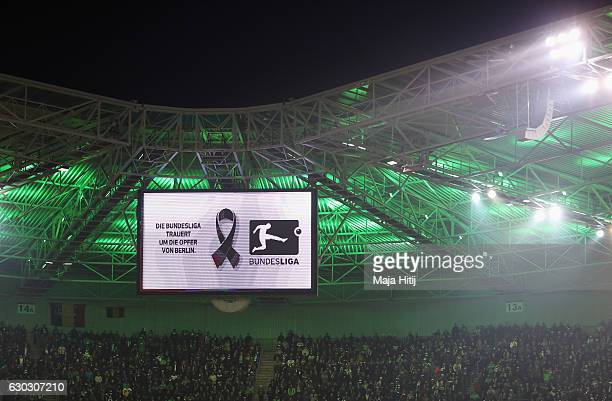 A view of the big screen as the teams and fans observe a minute's silence to remember the victims of the Berlin attack prior to the Bundesliga match...