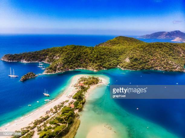 view of the blue lagoon, oludeniz, mugla, turkey - coastline stock photos and pictures
