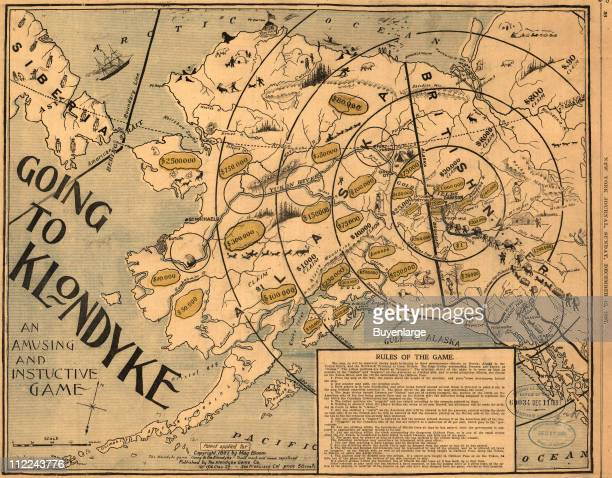 View of the board game 'Going to the Klondyke' which shows a map of Alaska and portions of northwest Canada along with the rules of the game 1897...