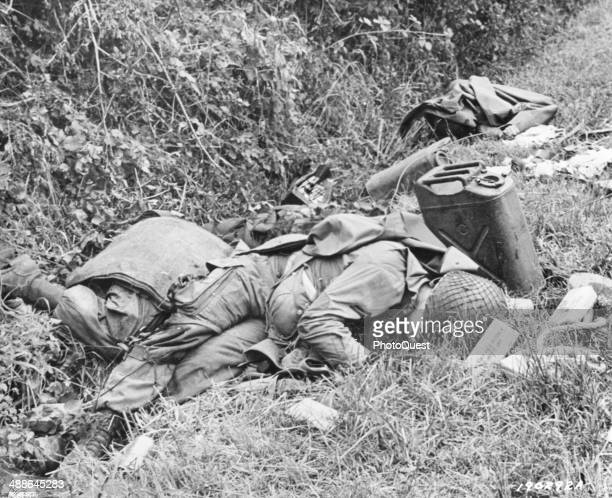 View of the bodies of American soldiers who died in the crashlanding of their glider during the invasion near St Marie Du Mont Utah Beach France June...