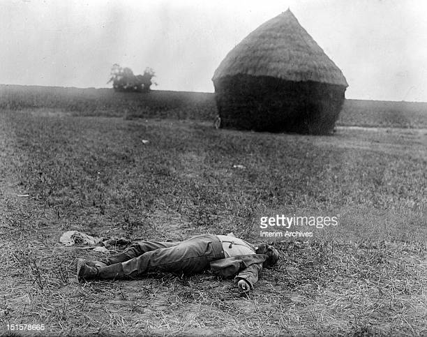 View of the body of a dead German lying on a field near the village of Villeroy in France during World War I