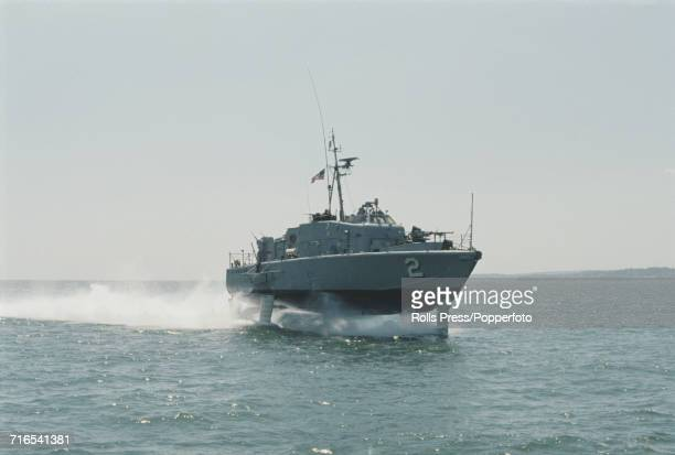 View of the Boeing built USS Tucumcari prototype hydrofoil boat contracted by the United States Navy undergoing tests in the English Channel near...