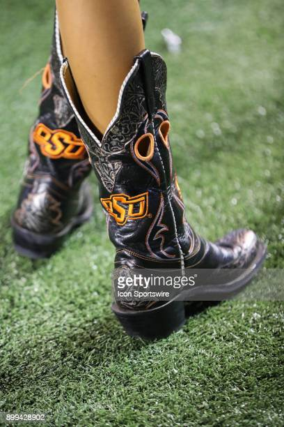 A view of the boots wore by Oklahoma State cheerleaders during the Camping World Bowl between the Virginia Tech Hokies and the Oklahoma State Cowboys...
