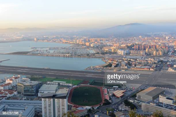 A view of the border between Gibraltar and La Linea Gibraltar is a tiny British Colony located in Southern Spain It has a population of 32000 in 2018