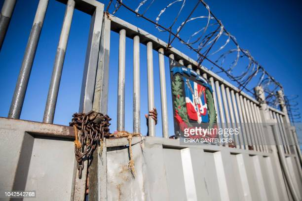 View of the border gate between Ouanaminthe in Haiti and Dajabon in the northwest of Dominican Republic where Haitians cross to sell goods in the...