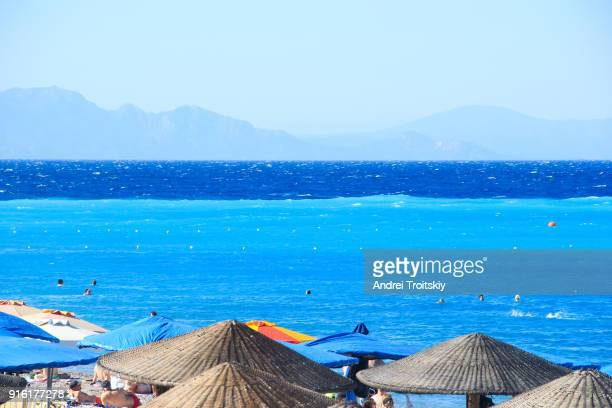 view of the border of mediterranean and aegean seas, rhodes, greece - rhodes dodecanese islands stock photos and pictures