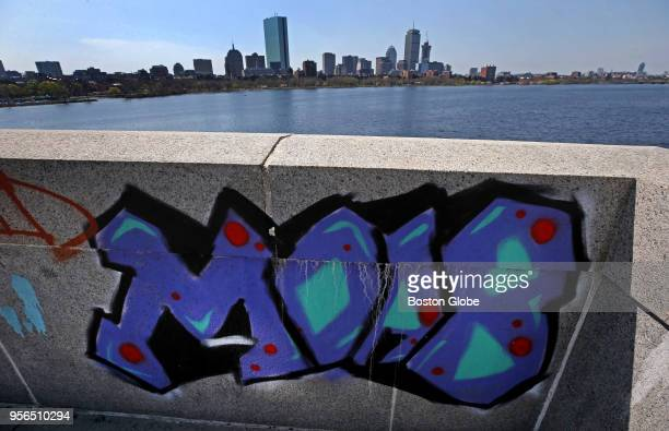A view of the Boston skyline form the Longfellow Bridge over the Charles River with graffiti in the foreground