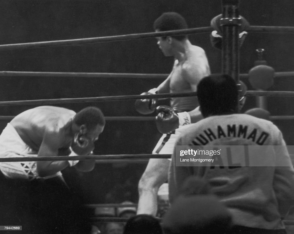 View of the boxing match between American heavyweights boxer Muhammad Ali (in ring at right) and Joe Frazier at Madison Square Garden, New York, New York, January 28, 1974. In a close match, Ali won on points and went on to meet George Foreman for the world heavyweight title.