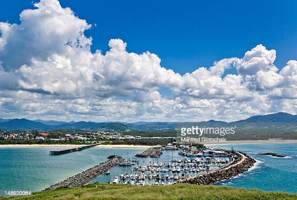 view of the breakwater with marina, and jetty beach. - coffs harbour stock pictures, royalty-free photos & images