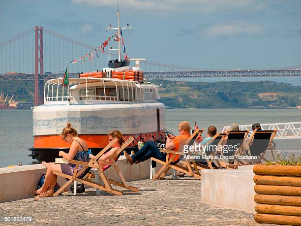 CONTENT] A view of the bridge 25 de Octubre that it links both banks of the Tagus or Tejo River in the riverbanks near to Cais do Sodre and a few...