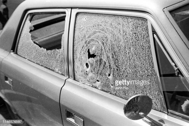 View of the broken windows of a parked car caused by bullets after the Ohio National Guard opened fire on antiwar protesters at Kent State...