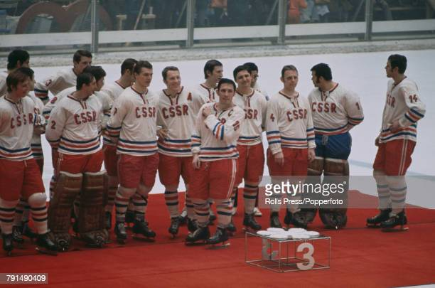 View of the bronze medal winning Czechoslovakia ice hockey team pictured together standing on the medal podium after finishing in 3rd place in the...