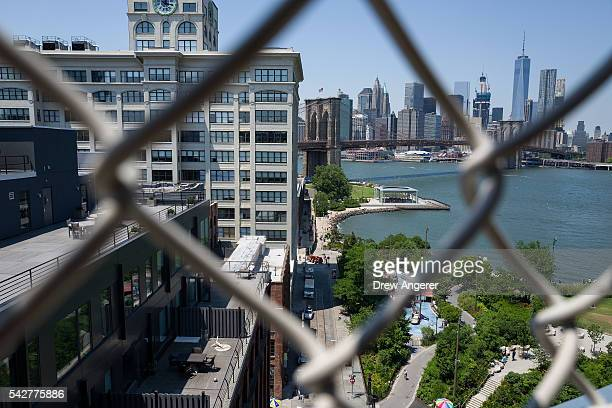 A view of the Brooklyn Bridge and DUMBO neighborhood on June 24 2016 in the Brooklyn borough of New York City According to a survey released on...