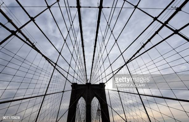 TOPSHOT A view of the Brooklyn Bridge before protestors with the '1804 Movement for All Immigrants' march with the Haitian community and other...