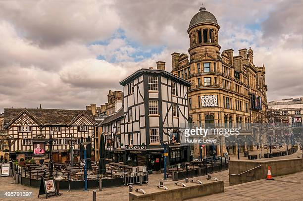CONTENT] A view of the buildings around Shambles Square Manchester UK
