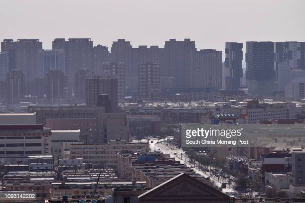 View of the buildings in Baotou city, Inner Mongolia, on Nov. 17, 2017. The metro construction in Baotou city has been suspended after Yu Zhengzheng,...