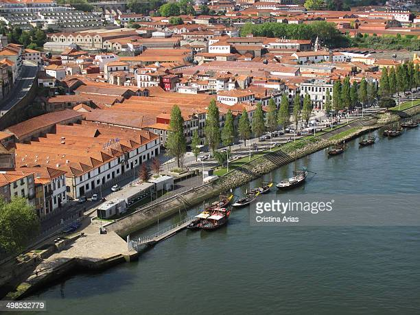 View of the buildings of the cellars in Vila Nova de Gaia from the top of Don Luis I bridge Portugal April 2014