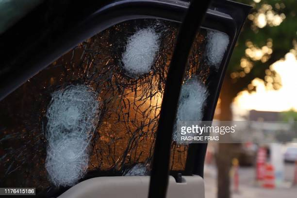 View of the bullet ridden window of a vehicle in a street of Culiacan state of Sinaloa Mexico on October 17 2019 Heavily armed gunmen in fourbyfour...
