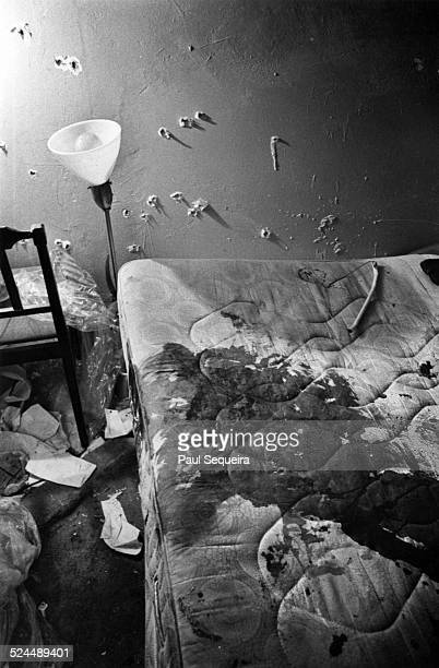 View of the bulletriddled wall and bloodstained mattress in Black Panther Party leader Fred Hampton's and Deborah Johnson's bedroom after the...