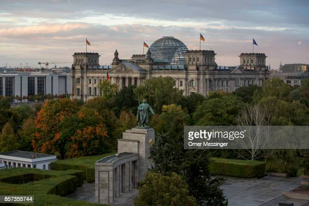 A view of the Bundestag and its glass dome with the monument to the soviet soldier in the foreground on German Unity Day on October 3 2017 in Berlin...