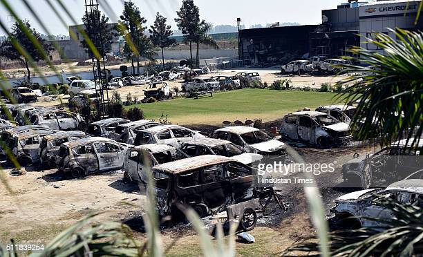 A view of the burnt car showroom after Jat protests for reservation in government services turned violent on February 23 2016 in Rohtak India Jats...