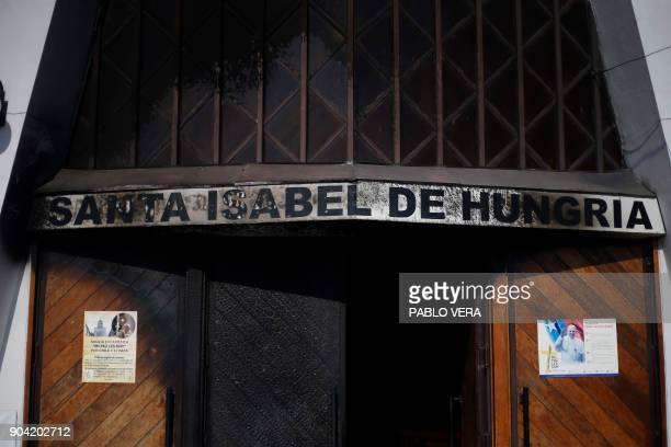 View of the burnt door of Santa Isabel de Hungria church in Santiago where an attack with an incendiary device occured and a threating message...
