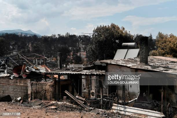 A view of the burnt out houses at the seaside resort of Mati eastern Attica region after the deadly fires swept the area earlier in the week on July...