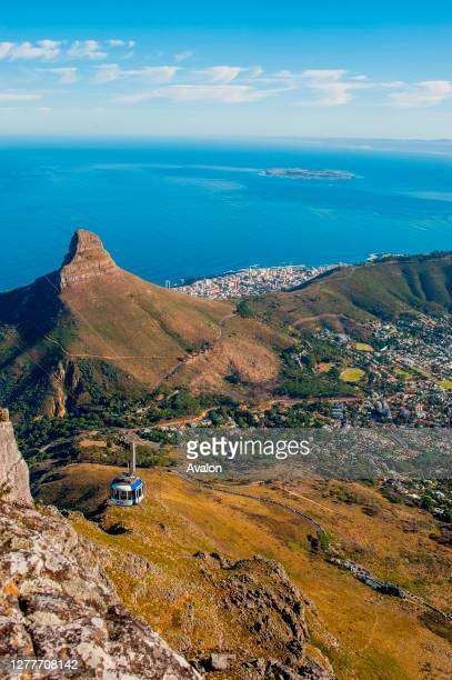 View of the cable car and Lions Head mountain from the top of Table Mountain in Cape Town, South Africa.