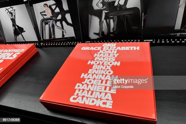 A view of the calendars on display at the CR Fashion Book Celebrating launch of CR Girls 2018 with Technogym at Spring Place on December 12 2017 in...