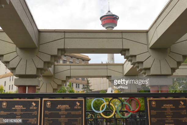A view of the Calgary Tower with Olympic rings built into railing at Olympic Plaza in downtown After the city of Graz in Austria a main contender for...
