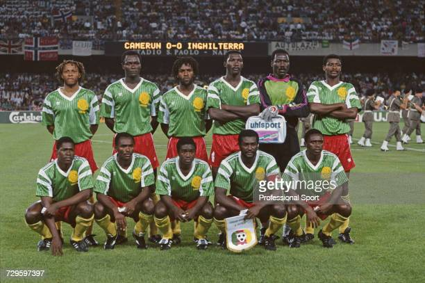 View of the Cameroon international football team posed together on the pitch prior to their quarter final match with England in the 1990 FIFA World...