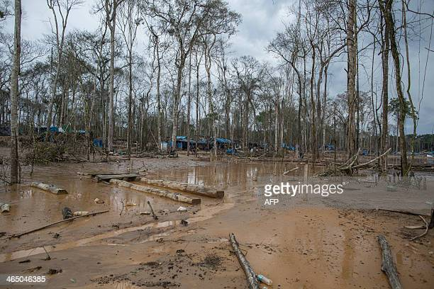 View of the camp and tailings produced by illegal gold mining in Mega 13 Madre de Dios region Peru on January 25 during a police operation AFP PHOTO...