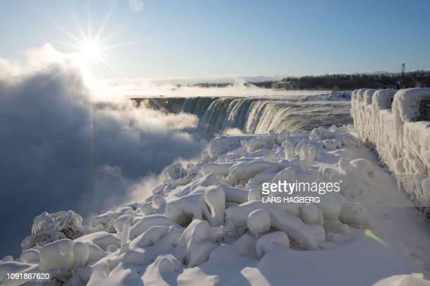 TOPSHOT A view of the Canadian Horseshoe Falls as steam rises from the falls in Niagara Falls Ontario Canada on January 31 2019 A brutal cold wave...