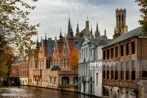 view of the canals of bruges (groenerei canal), bruges, belgium - unesco stock-fotos und bilder