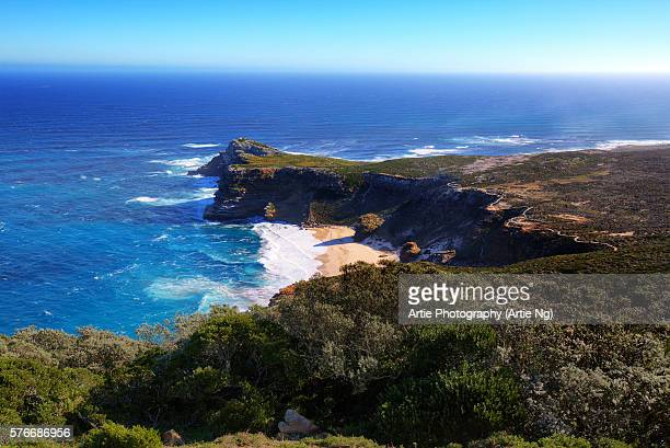 view of the cape of good hope from the coastal cliffs above cape point overlooking dias beach, cape peninsula, south africa - cape stock pictures, royalty-free photos & images
