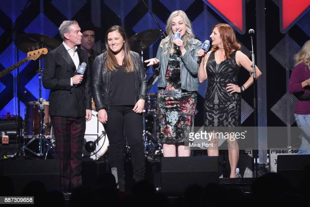 A view of the Capital One winner onstage with Elvis Duran and the cast of The Morning Show during Q102's Jingle Ball 2017 Presented by Capital One at...