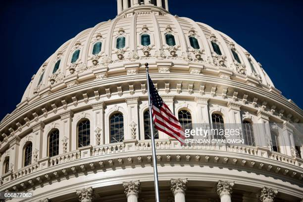 A view of the Capitol dome is seen on Capitol Hill March 23 2017 in WashingtonDC / AFP PHOTO / Brendan Smialowski