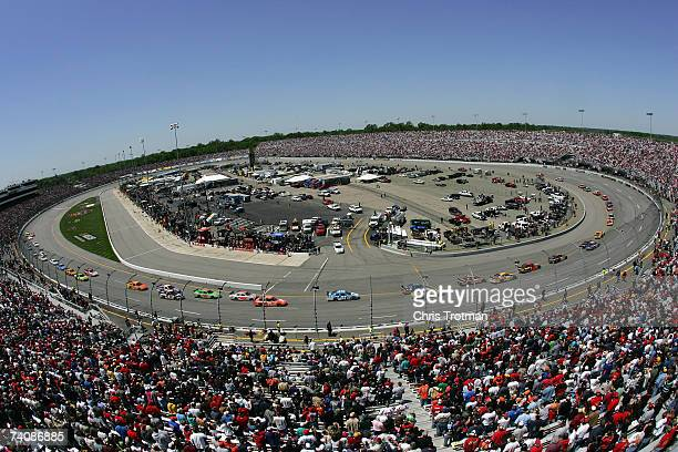 View of the cars racing on the track, during the NASCAR Nextel Cup Series Jim Stewart 400 at Richmond International Raceway on May 6, 2007 in...