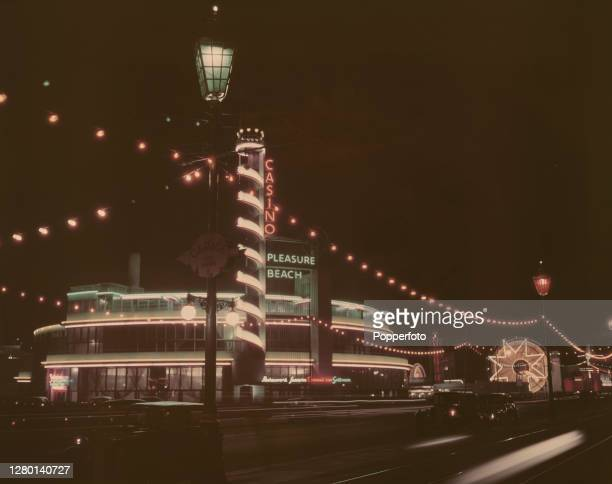 View of the casino and pleasure beach buildings lit up during the Blackpool Illuminations annual lights festival in the seaside resort of Blackpool...