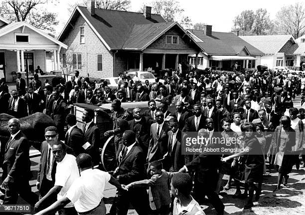 View of the casket of assassinated Civil Rights leader Dr Martin Luther King Jr borne on a muledrawn cart during a massive funeral procession through...